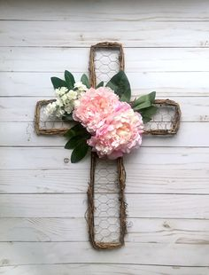 This lovely rattan and wire cross filled with pink peonies and white floral welcomes all those who enter your home! Crosses Decor, Wall Crosses, Grave Flowers, Cross Wreath, Cross Crafts, Easter Cross, Diy Arts And Crafts, Easter Wreaths, Diy Wreath