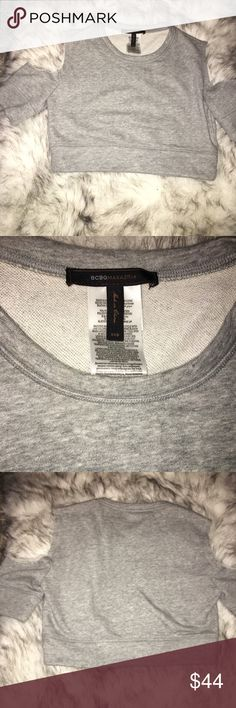 BCBG grey cropped sweatshirt only worn once! BCBG grey cropped sweatshirt super comfy only worn once size XXS and super chic can be dressed up or down BCBG Tops Crop Tops