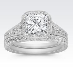 Vintage Halo Round Diamond Wedding Set in Platinum with Princess Cut Diamond from Shane Co. Available with your choice of ruby, diamond or sapphire center stone.
