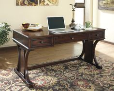 - Description - Dimensions - More Info Ashley Furniture Devrik Home Office Desk With the stylish look of the framed panels nestled against artistically curved brackets supporting the contemporary desk