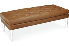 L9139-10  Ottoman    Overall: W59 D27 H19   Fabric / Leather: Sicily Camel    Lucite Legs conference room?