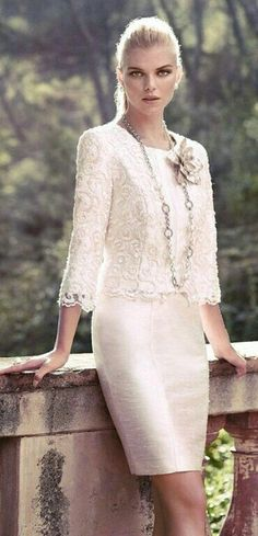 I love the suit 'look' softened with lace on the top