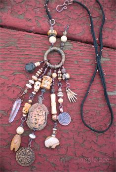 The Thai Buddhist amulet at the heart of this amulet necklace is new, but made to look like an old piece. It is made of low-fired clay and gold-leafed