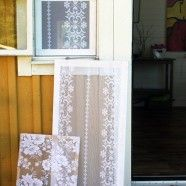 Lace window screens! I think this could work if you have casement windows like these - the screen would stay inside and wouldn't get filthy