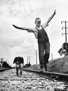 Larry Jim Holm with Dunk, His Spaniel Collie Mix, Walking Rail of Railroad Tracks in Rural Area Fotografie-Druck von Myron Davis bei AllPosters.de