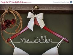 ON SALE Personalized Wedding Hanger, bridesmaid gifts, name hanger, brides hanger. $13.99, via Etsy.