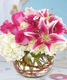 """Southern Charms-This garden bouquet of southern favorite flowers includes hydrangeas, stargazer lilies, gerberas, and our luxurious roses in a 6"""" bubble bowl with a swirl of curly willow. With our local and nationwide delivery, you can bring the warmth of these summer flowers directly to you or that special someone from right here in Wilmington NC! #ValentinesDay #ValentinesDayFlowers #RomanticFlowers #Lilies #Roses #Hydrangeas #GerberaDaisies #JuliasFlorist #WilmingtonFlowers"""