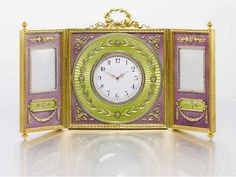 Russian auction Sotheby's in June - pre-auction display in Moscow Faberge triptych clock and frames in lavender and green guilloche