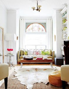 Tips for layering rugs: Use a cowhide or a sheepskin on top of a rectangular rug. The juxtaposition of an organic shape over straight lines always looks fabulous!