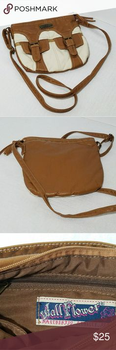 "Wallflower Design Leather Shoulder Cross Body Bag Pre-owned excellent condition, caramel color, dimensions 9""H x 10""L x 2 1/2""W, messenger & cross body style, leather material, adjustable strap, zip closure, 2 tone pattern. Excellent daily cross body shoulder bag outside leather material inside cotton. This Wall Flower double buckle bag is very clean and ready to use still have leather smell, strong, and durable. 2 double buckle pockets on the outside, inside 2 open pockets, and 1 zipper…"