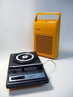 1970s Vintage Philips 22GF Portable Orange Record Player Pickup.via Etsy.