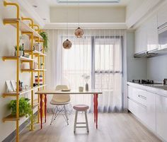 Talk about dual personalities. This kitchen in Taiwan is all business on one side, and party on the other! Without that bright yellow pipe-and-wood shelf, this kitchen would be fairly boring,  but that punch of color makes it stand out in a wonderful way.
