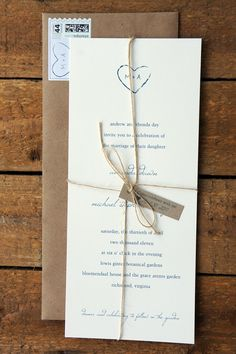 Letter Press invitation, if possible. Accented with twine or burlap. Image keeping in theme.