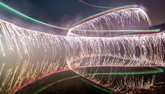 "Photographer Calder Wilson added an explosive new method to his long exposure ""light paintings"" earlier this year when he was struck by a brilliant notion: Strap some leftover New Year's fireworks to the back of a UAV, light them up and then lift off."