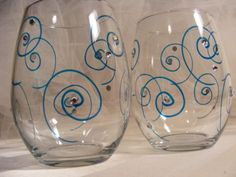 painted wine glasses with aqua swirls and Swarovski crystals - perfect for a beach wedding