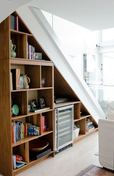 Molly and John's Light-Filled Home for Five, Great use of underside of stairs. Formerly empty space. Now, double layers of storage. Hidden Spaces, Small Spaces, Shelves Under Stairs, Stair Shelves, Shelving, Stair Storage, Home Organization, Apartment Therapy, House Tours