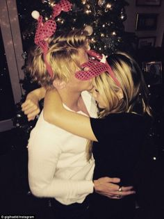 Loved-up Christmas: Gigi Hadid and Cody Simpson look closer than ever as they spend Christmas in each other's arms