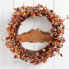 This is so beautiful! I love the engraved wood plaque in the center with the pumpkin design! It's the Personalized Fall Berry Wreath from Personalization Mall ..  perfect for Fall, Thanksgiving and Halloween! #fall #acorns #wreath #personalized