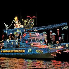 In Newport Beach, California, the Beek family watches thousands of Christmas lights glide across the water. Tropical Christmas, Beach Christmas, Christmas Travel, Coastal Christmas, Beautiful Christmas, Christmas Holidays, Merry Christmas, Christmas Light Displays, Holiday Lights