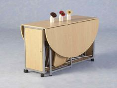 Image from http://fortikur.com/wp-content/uploads/2014/01/Modern-Folding-Dining-Table-and-Chairs.jpg.