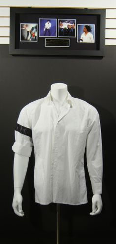 """Michael Jackson exceedingly rare previously owned and concert worn costume made white cotton long sleeve oversized shirt from Jackson's Dangerous World Tour era (1992-1993). The King of Pop wore this shirt, with his trademark black armband at right arm, during his performances of the song """"Black or White"""". There are two labels inside the shirt, one from the manufacturer (Slama HBA Wien 1992), the other from Jackson's long-time costume designers """"Dennis Tompkins & Michael Bush"""". Will be…"""