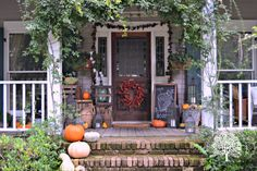 Seeing as the vines on this porch already frame the home's front door, it only makes sense that any decorations should do the same. Wicker baskets and barrels of fall treats add extra dimension.