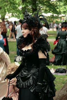 Victorian black goth outfit. Not so sure about the ornament on her head, but other than that: respect!