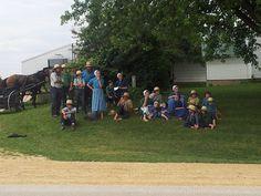 Amish Families watching RAGBRAI riders ride by.  Northeastern Iowa RAGBRAI 2014