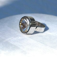 Modernist Kaunis Koru ring from Finland. Set with a sparkly clear 16mm quartz crystal mounted in a tall silver bezel