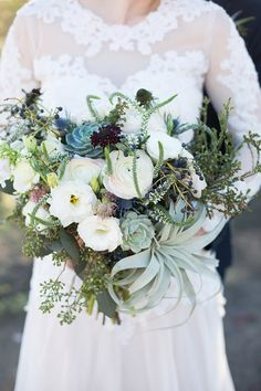 White and purple bridal bouquet with succulents | Modern Geometric Wedding Inspiration via @bohowedandlife, pics by Denise Karis Photography