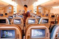 Singapore Airlines flight attendant on A380 economy class.