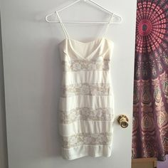 White dress with flower lace design White flower lace design mini dress. Good condition. Size small Sweet storm Dresses Mini