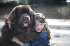 Gracie would never let a little slobber stop her from giving one of her dogs a hug.