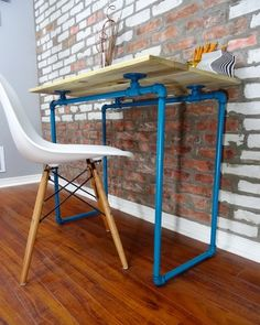 Crazy about this DIY Pallet Wood Desk with Turquoise Pipes! This would be great for home office space or a kid's room. The industrial pipe look makes a great modern touch. Check out the project on RYOB Nation.
