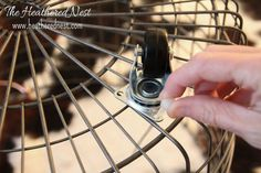diy rolling wire baskets.  use zip ties to attach wheels!   BRILLIANT!