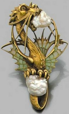 Art Nouveau carved dragon pendant in 18k yellow gold set with two baroque pearls, wings decorated with plique-à-jour enamel, French, circa 1900.