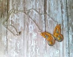 Resin Butterfly Necklace, made in a Gold, Silver, and Copper tone