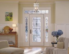 Light beams through a Pella fiberglass entry door with full-light sidelights in Castile decorative glass.