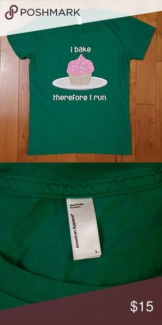 "American Apparel ""I Bake Therefore I Run"" Tee American Apparel Graphic Tee.  I Bake Therefore I Run.  Size womens large.  Super cute and in excellent condition.  Printed on a high quality 100% cotton American Apparel tee. American Apparel Tops Tees - Short Sleeve"