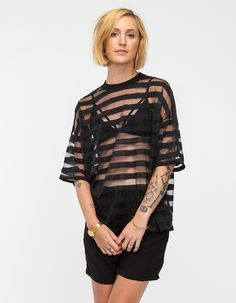 bedaf5424c Sheer stripe paneled oversized top with tee-shirt styling, crew neckline,  and oversized shoulders for loose relaxed fit.
