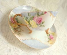 Antique Fine Porcelain Hand Painted Teacup Saucer Blue with Pink Yellow Roses Wide Mouth Footed