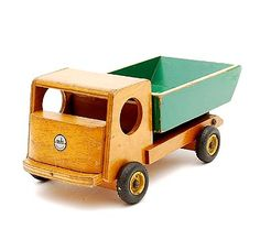 Wooden toy truck with green and yellow painted container with original metal wheels with rubber tires design Ko Verzuu ca.1935 executed by ADO Arbeid Door Onvolwaardigen Berg en Bosch / the Netherlands