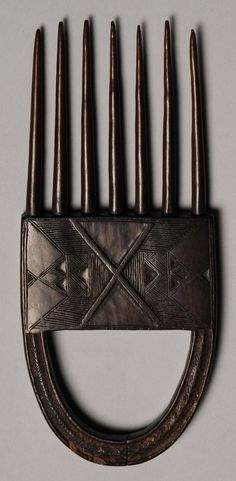 Africa | Comb from the Dan people of the Ivory Coast and Liberia | Wood, fine aged brown patina