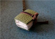 Book Necklace     http://www.etsy.com/listing/60872879/book-necklace-the-forest-is-my-throne