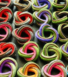 Two color eternity brooches by woolly  fabulous, via Flickr