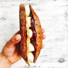 Lower the carbs of the typical sandwich by using something other than bread. @restoring_radiance used sweet potato for this banana, almond butter, and Fiordifrutta Raspberry Jam sandwich.