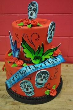 Great idea for a bday cake with sugar skulls....
