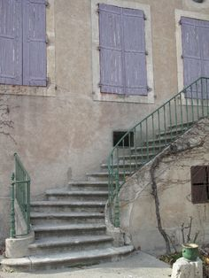 Domaine du Bosc. Wine chateau in the south of France. Lavender shutters. Pale green wrought iron railing. Stone steps. Indeed.