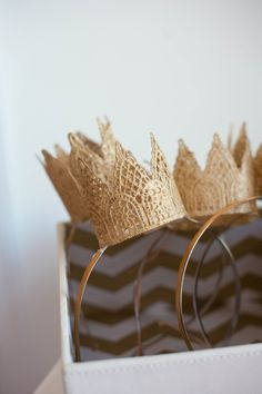 adorable crowns! no tutorial but looks like starched lace spray-painted gold, adhered to headbands