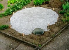 Gravel it for the bottom, also use cardboard under the gravel for extra soil nutrition and weed control.